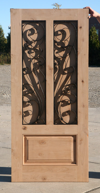 Exterior Rustic Door With Wrought Iron Venting Grills