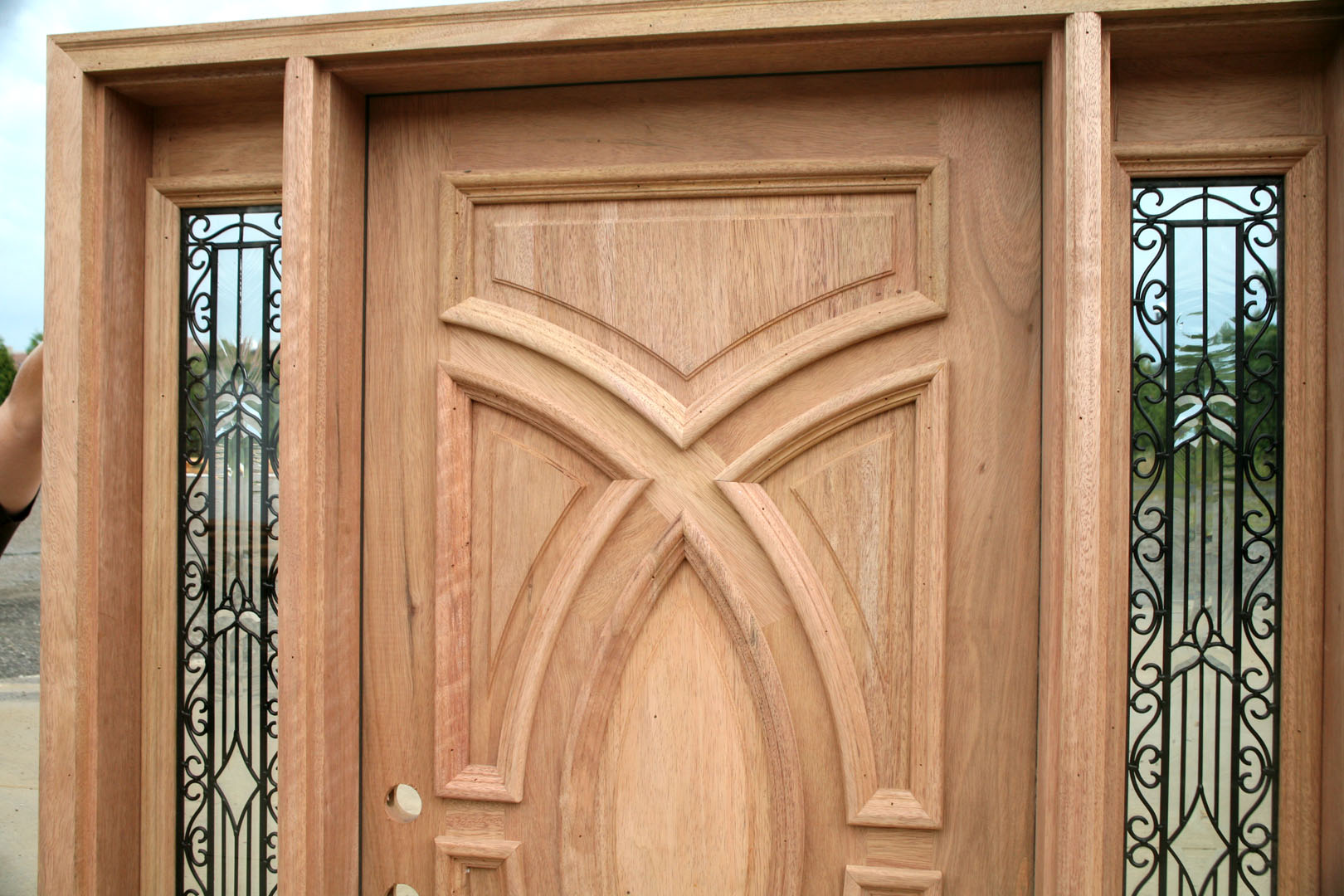 Exterior wood doors with wrought iron glass sidelights for Wooden outside doors