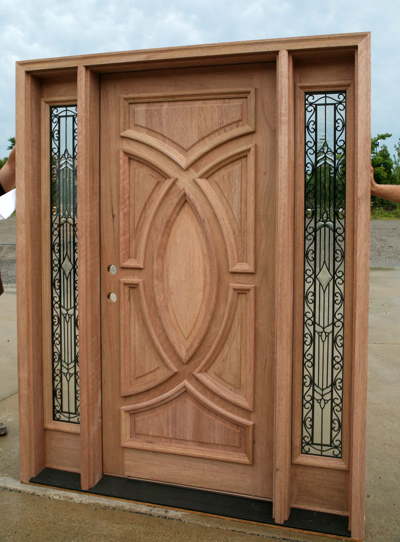 Exterior wood doors with wrought iron glass sidelights for Hardwood doors