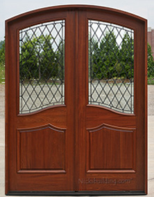 Arched double door with wrought iron glass