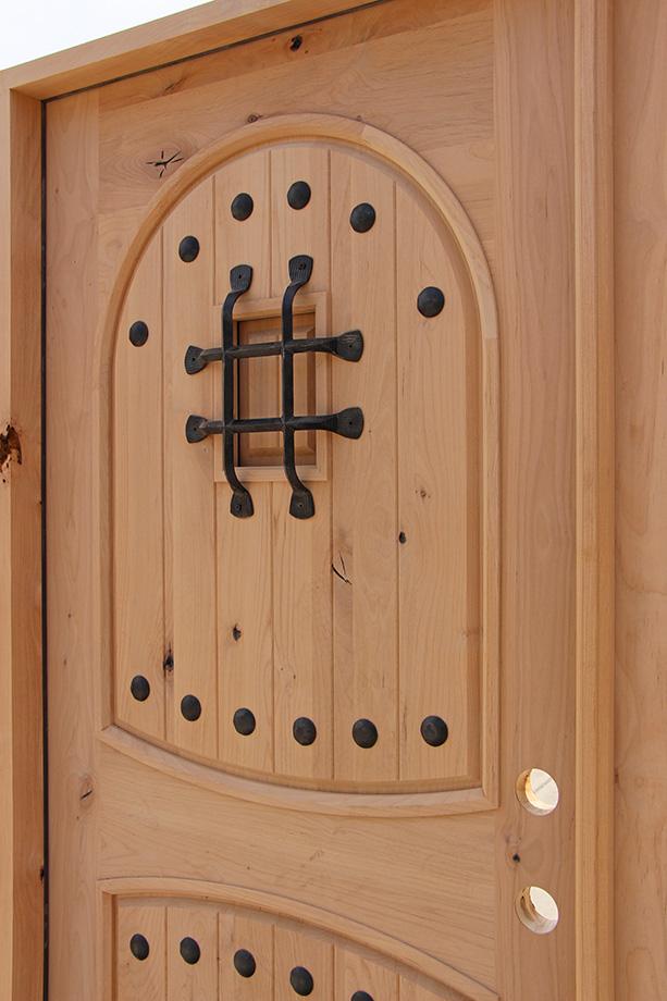 Exterior Knotty Alder Double Doors Arched Panels