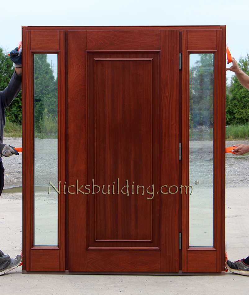 Exterior: Copper Door With Sidelights