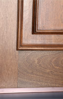 copper exterior door has mahogany wood inside