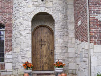 arched top rustic wood door