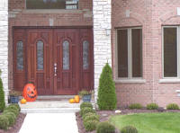 house with large entrance double wood door with sidelights