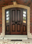 arched carved wood door