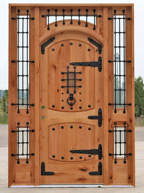 Rustic Arched Doors With Wrought Iron Bars