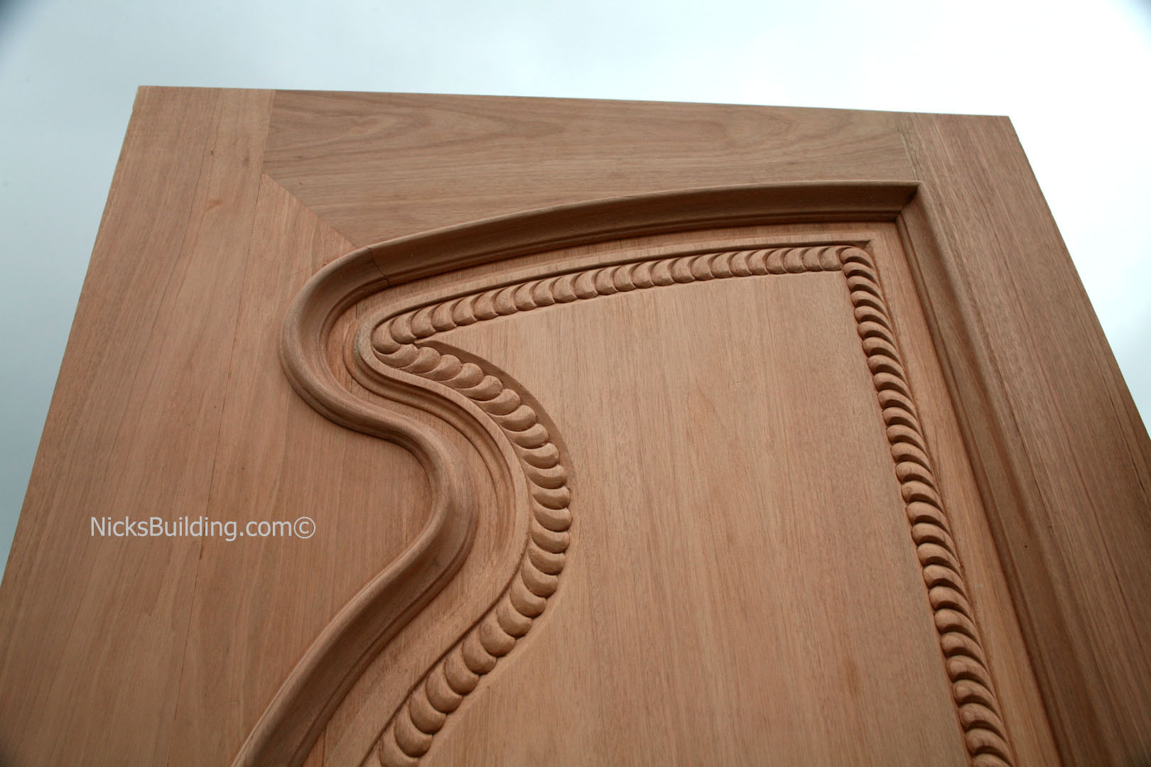 Hand carved doors exterior hand carved mahogany doors for Hand carved wood doors
