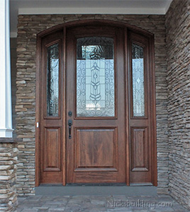 arched mahogany entry door with sidelights installation