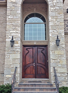 carved exterior mahogany double doors