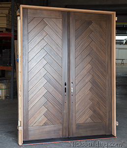 Custom Ordered Mahogany Double Doors with Herringbone Panel Design