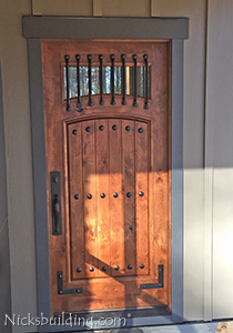 Knotty Alder exterior door with iron bars