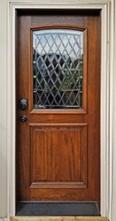 Mahogany 2 Panel Exterior Door with Arched Glass Application