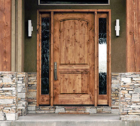 rustic entry door with sidelights