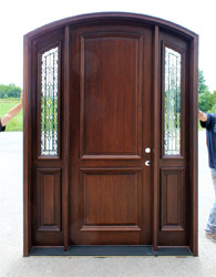Arched Bellagio Door with iron classic sidelights