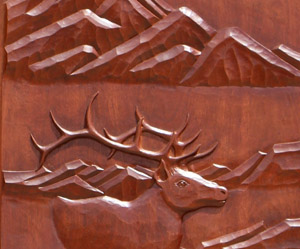 Carved ELK doors closeup