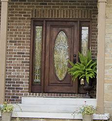 mahogany front door with full oval glass