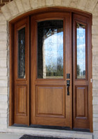 Arched Mahogany Door Installed by Bloom