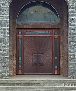 Castle Home with Custom Copper Double Doors with Sidelights and Transom
