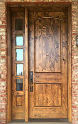 rustic wood entry doors and sidelites