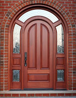 round top door system in mahogany with surround transom
