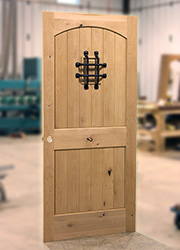 Interior knotty lader doors with speakeasy and iron grill