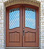 arched top exterior double doors with glass