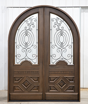 arched top double doors with wrought iron