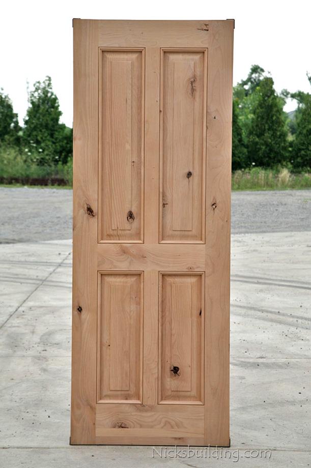 Rustic exterior wood doors in knotty alder for Rustic exterior doors