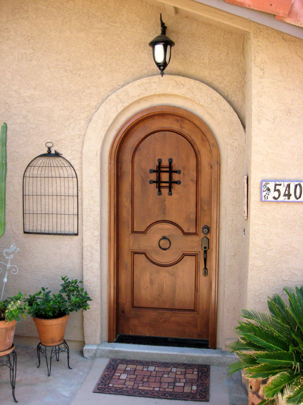 Rustic round top doors rustic arch top entry doors for Front door arch design