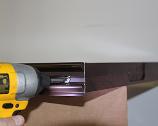 wood door sweep installation with flange head screws