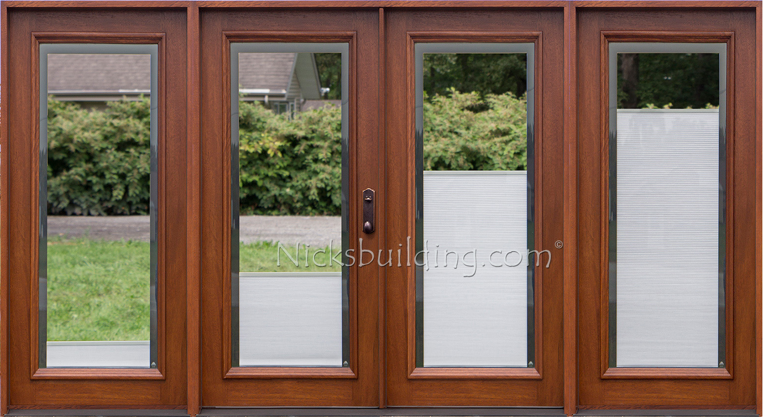 wood patio doors with shades between glass
