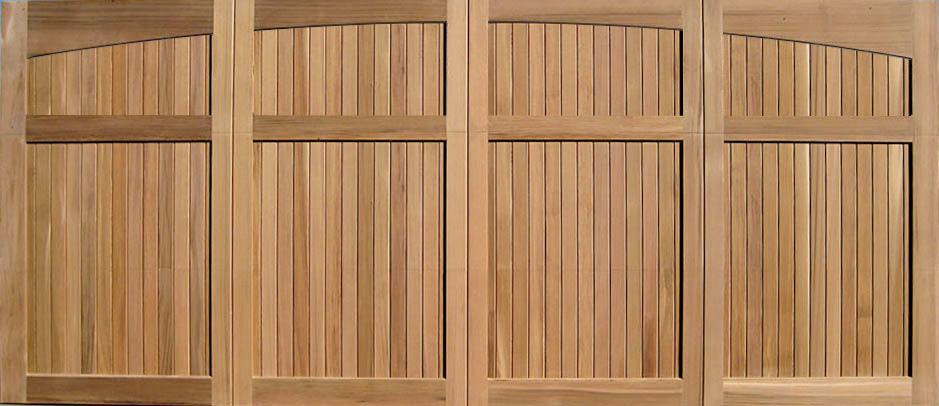 Wood garage doors wooden overhead door paint grade for Cedar wood garage doors price