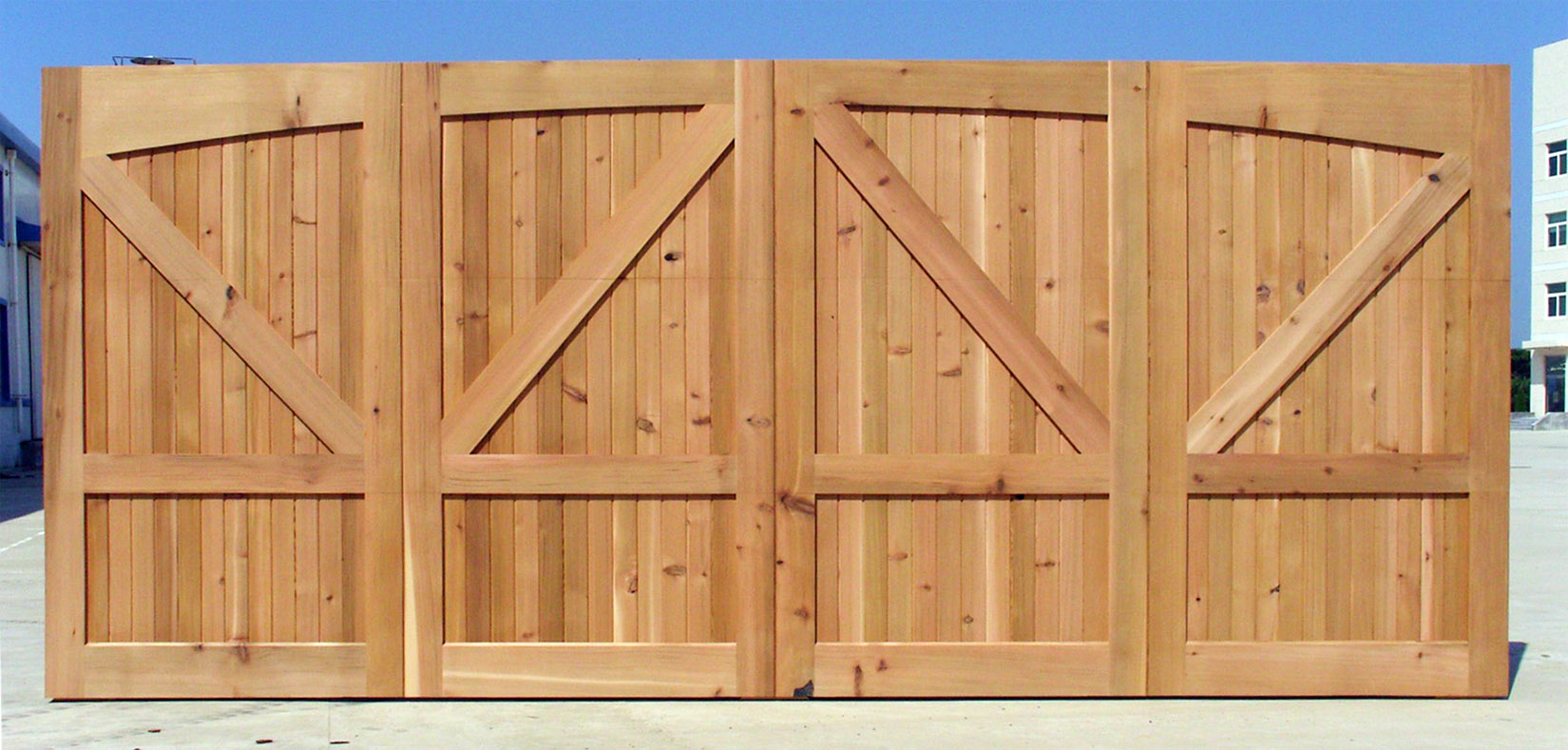 Wood garage doors wooden overhead door paint grade for 16 x 10 garage door cost
