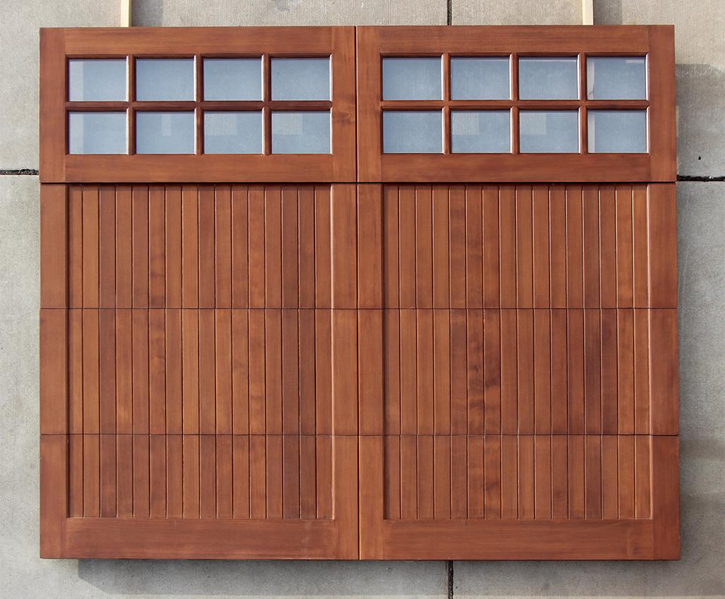 Wood garage doors wooden overhead door paint grade for Wooden garage door designs