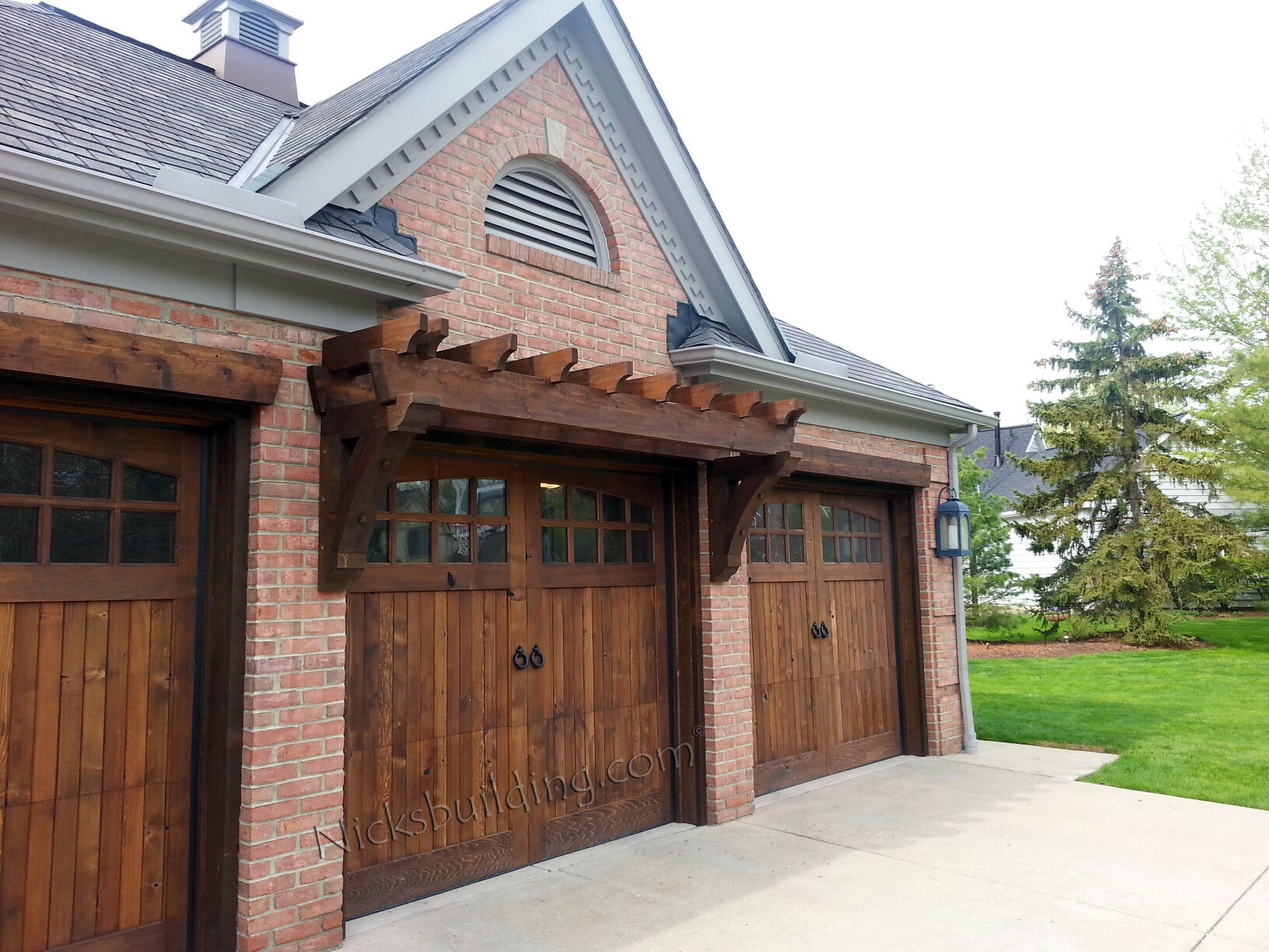 Wood overhead garage doors and carriage garage doors for for Wood looking garage doors